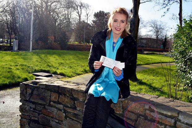Amy Reidy from Cordal pictured showing off the tickets bought for her so generously by a complete stranger, Stefan Roth. Photo by Fergus Dennehy