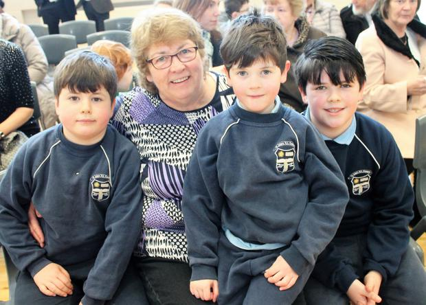 Elliott, Carter and Hayden O'Neill with their grandmother, Carmel Horan, at St John's NS, Kenmare. Photo by Sinead Kelleher