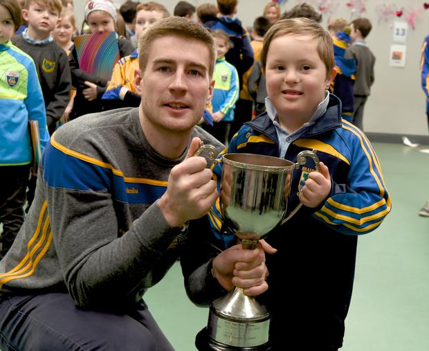 Nathan Breen (left) – captain of the Beaufort team, All- Ireland Junior Football Champions – with Fionn Van Bladel at Cullina NS. Photo by Michelle Cooper Galvin
