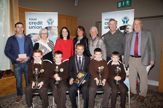 Gaelscoil Mhic Easmainn, Tralee, who are the 2019 Chapter 23 Under-13 winners of Credit Union Primary Schools Table Quiz at Ballyroe Heioghts Hotel,Tralee. Front: Grace Ní Dhomhnaill, Ruairí Ó Loingsigh, John Long (Chapter 23 Chairperson), Iarla Ó Lionaird and Donncha Mac Uileagóid. Back: Donal Ó Súilleabháin, teacher; Lil Tangney; Suzanne Ennis (Cara Credit Union); Cáit Uí Chonchúir (Principal); Tom Lawlor, Liam Ó Conchubhair (Deputy Principal); and John O'Regan (Vice Chair of Clanmaurice Credit Union)