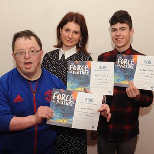 Three of the five Kerry winners in the All-Ireland Credit Union art contest (from left): James O'Shea from Beaufort, winner in the adult category; Aneta Majchrzak from Killorglin, also a winner in the adult category; and Jonathan O'Keeffe, Killarney, winner in the 14-to-17 age category