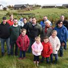 Cromane residents Emily and Sophie O'Sullivan, Joshua and Isabel Sweeney (second row from left) Sean Reilly, Martin Sweeney, Cllr John Francis Flynn, Patrick O'Sullivan, Bernie and Joan Willis (back from left) Dylan McCarthy, Noreen and Adam O'Sullivan, Joshua and David O'Sullivan and Florence McCarthy at the bank in Cromane Upper. Photo by Michelle Cooper Galvin