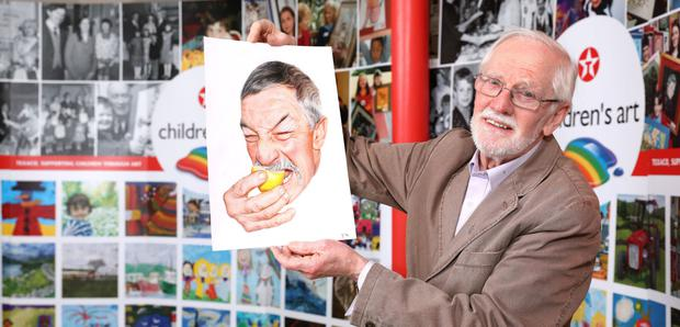 Texaco Children's Art Competition adjudicator Eoin Butler pictured holding the artwork of St Brendan's College Killarney student Jonathan O'Keeffe. The artwork is entitled 'Bitter Phil'