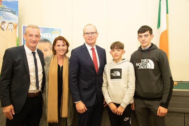 Mayor of Listowel Mike Kennelly and his family, wife Colette and sons Aaron and Mike Jnr welcoming Tánaiste Simon Coveney to St Michael's College on Thursday night