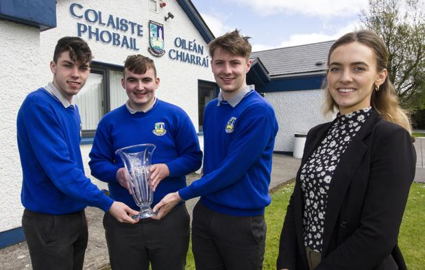 Castleisland Community College teacher, Cáit McEllistrem with her National Garda Youth Achievement Safety Award winning students, from left: Eamon Nolan, Kevin Lenihan and James McDonnell with the spoils of their achievements. Photo by John Reidy