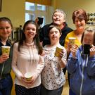 Members of the 'Inspired' group pictured with staff as they show off some of the delicious treats they had on offer at their fundraising coffee morning as part of Alzheimer's Tea Day last Thursday morning. Photo by Fergus Dennehy