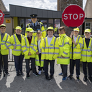 Listowel Garda Frank Stafford pictured with primary school students in Listowel as they take over traffic duties as part of the Junior School Warden Programme. Photos by Domnick Walsh