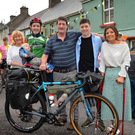 Tomás Mac a'tSaoir with his parents Diarmuid and Lulu, brother Gearóid and sister Bríd in Baile an Fheirtéaraigh after he arrived home on Saturday from his epic cycle from Cairo to Capetown
