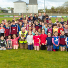 The young stars of Listowel Athletics Club celebrating the winning of the overall County Award for athletics at the Frank Sheehy Park in Listowel last week. Photos by John Kelliher