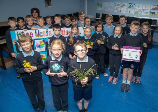 Pupils from fourth class in Ardfert NS show off the work they did on their recent school project in which they studied whether weeds are useful or not
