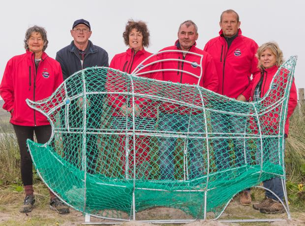 Caroline Donnelly, Patrick Murphy, Ger Deasy, Michael Donnelly, Jerry Clifford and Helen Wilson at the launch of 'Goby, The Ocean Plastic Bin' last Thursday. Photo by Michael Donnelly