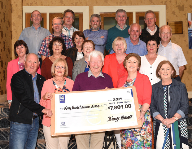 Noreen Casey, Kerry Parents and Friends Association, (front, fourth from left) with a cheque for €7801 from the Biddy group. FRONT: Paul Cremin, Catherine Moynihan, Pat Moriarty and Eilis Lucey with Nuala O'Doherty, Eileen Scully, Mary Kissane, Kathleen Fitzgerald, Joan Healy, Sarah Griffin, Tim Kissane, Gerard Fitzgerald, Paudie Kissane, Phil Hanifin, Denis Crowley, Donie Doherty, Noel Lucey and Nike Kearney at The Holiday Inn, Killarney, on Friday. Photo by Michelle Cooper Galvin