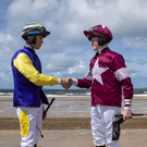 Young riders Dylan Browne McMonagle and Sam Ewing meeting up on the beach before the first race of the day. Photo by Domnick Walsh