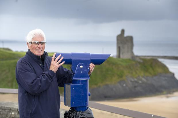 Chairperson of the Ballybunion Tidy Towns Noel Nash at the newly-installed telescopic viewing area above the Ladies' Beach. It's a free amenity delivering incredible views of everywhere from Kerry Head to Co Clare. Photo by Domnick Walsh
