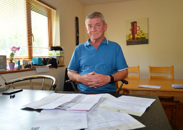 Billy Noonan with letters informing him that Kerry County Council won't provide him with accommodation as he and his 23-year-old daughter face homelessness when they leave their rented house in Mullinaglemig this weekend. Photo by Declan Malone