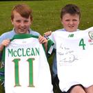 Sean Cox with James McClean's jersey and Brian O'Sullivan with Shane Duffy's jersey from the Ireland versus Denmark game. Photo: Michelle Cooper Galvin
