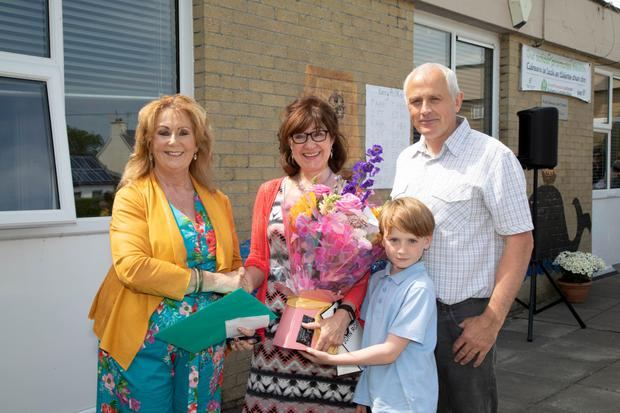 Teacher Joan Holland receives a farewell retirement gift from Principal Betty Stack and Tadhg O'Sullivan from the Board of Management last week as well. Photo by Joe Hanley