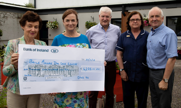 Reneé White and Trish White pictured presenting a cheque for over €6,000 to Paddy Garvey, Aidan Kelly and Rose Daly of the Baile Mhuire Day Care Centre. Photo by Joe Hanley