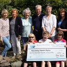 A cheque for €1,375 was presented to the Recovery Haven on Monday morning by nine-year-old Julie Walsh who cut off over 14 inches of hair for charity. Front l-r: Katie, Tommy and Julie Walsh. Back l-r: Claire O'Doherty, Marian Barnes, Elitzabeth Morris Gros, Michael Maher, Helen Walsh, Sharon Villa and Maureen O'Brien. Photo by Joe Hanley