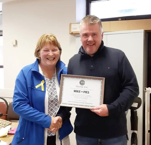 Secretary of the Listowel Hospice Jenny Tarrant pictured presenting Aidan O'Connor of Mike the Pies with a certificate of thanks and appreciation for all hos fundraising efforts for the Hospice over the years.