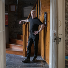 Exit stage left: Joe Murphy in his trademark black, departing St John's having managed it since the Anglican church reopened as a theatre in 1990. Photo by Domnick Walsh