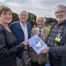 Mary O'Halloran, Noel Harrington, Tom Lawlor and Joe O'Sullivan with a copy of Bishop Bill Murphy's homilies. Photo by Domnick Walsh