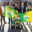 Ken Tobin (Tralee Chamber Alliance), Cllr Pa Daly, Cllr Sam Locke, Mayor of Tralee Jim Finucane, Gene Foley, Colm Nagle and Fionn and Farren O'Dálaigh pictured celebrating the news that a big screen will be erected in the Square in Tralee this Saturday which will show the All Ireland Final replay between Kerry and Dublin. Photo by Fergus Dennehy