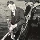 A young Joe C Keating pulling up the transatlantic cable