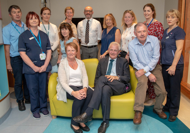 Parentso f the late Donal Walsh, Elma and Fionnbar, seated front at the opening of Donal's Den in the Palliative Care unit at University Hospital Kerry last week. Elma and Fionnbar are pictured with Ann McAtamney, Dr Patricia Sheehan, John Sheehan, Eimear Hauissey, Maura Sullivan, Dr Des McMahon, Joan Carmody, Andrea O'Donoghue, Mai O'Connell, Aine Moriarty and Kerry Hospice Foundation Chairperson Joe Hennebery
