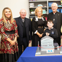 Ben Murphy, a pupil of Scoil Nuachabháil in Ballymac who was was honoured to cut the cake at the opening of the new extension of the school on Friday. From L-r: Siobhan Curran, Fr Gearóid Walsh (PP), Teresa Murphy (BOM), Ray Browne (Bishop of Kerry), Florence Ahern and Michael Bolger (Principal)