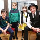 Oisín Hurley, Darragh Finnegan and Nicole O'Connor with Storyteller Ray O'Sullivan