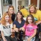 Majella, Maria and Meabh O'Connell had 10 inches off their hair on Wednesday at Hairwork studio in Tralee. Front Meabh, Majella and Maria O'Connell. Back: Carrie Ann Clifford (hairdresser) and Kathleen Collins (Recovery Haven)