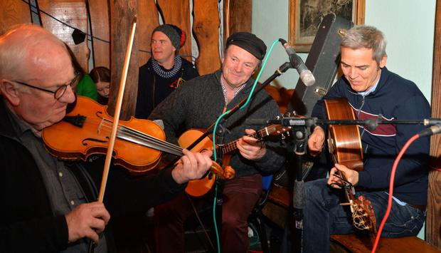 Music and song was flying out the door of Curran's pub on Saturday night as Laurence Courtney (centre) celebrated his 70th birthday and launched his debut CD. Photo by Declan Malone