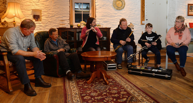 Aoife Granville, Cillian Ó Briain and Seán Michael Redican playing tunes in Baile Móir on Monday night with Mike Fitzgerald (left), Ian Crusher and Meg Fitzgerald (right) among the listeners. Photo by Declan Malone