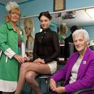 Hairdresser, Nora Drumm (left), preparing for a 2012 'Castleisland Capital of Fashion' event with Aisling O'Connell, model and Monica Prendiville, former national president of the Irish Country-Women's Association. Photo by John Reidy