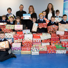 Pupils of Ardfert NS, their principal Betty Stack and teacher Aine Daly presenting over 200 shoeboxes full of toys to Dan Murphy of the Christian Fellowship in Listowel. Photo by Joe Hanley