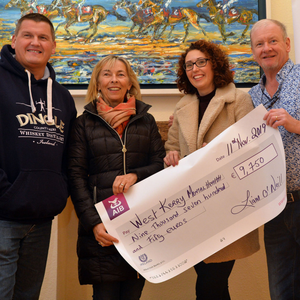 Graham Coull of Dingle Distillery and artist Liam O'Neill presenting a cheque for €9,750 to Máire Treasa Ní Chonchúir and Mairéad Clifford of West Kerry Mental Health Association. The money was raised in a single day in Liam's studio in the Colony during this year's Dingle Food Festival. Graham, who is from Elgin in the Speyside whiskey-making region of Scotland, is just finding his feet in Dingle. He took up the job of Master Distiller with Dingle Distillery a month ago and brings considerable experience to the task, having previously worked in the the Glen Moran and Glenfiddich distilleries in Scotland