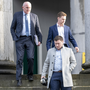 Jackie Healy-Rae (front), his brother Kevin Healy-Rae (back) and their solicitor Pádraig O'Connell leaving Tralee District Court on Monday where both brothers were convicted of assault. Photo by Domnick Walsh