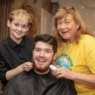 A close shave for John McCrohan, a 6th year student from Mercy Mounthawk as he prepared to have his beard shaved by Laura Hogan and Helen Collins (Recovery Haven) at the Recovery Haven fundraising shave night in the Rose Hotel last Wednesday