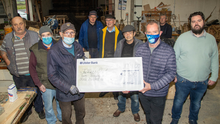 Members of Tralee Men's Shed pictured receiving a cheque for €2,300 from Ger McDonnell last week. The money is the proceeds from Ger's 18km swim in September. Photo by Joe Hanley
