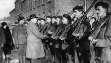 British Chief Secretary for Ireland Sir Hamar Greenwood inspects Auxiliary 'Black and Tan' troops in Dublin in January 1921