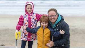 Aisling, Nathan and David Lawlor from Banna out to help clean their beloved beach. Photos by Domnick Walsh