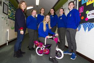 Katelyn Brennan, Castleisland trying out one of the donated bicycles while promoting the Castleisland Community College campaign to collect unwanted models for a Chernobyl charity. Included are: Teacher, Doreen Killington with: AnnMarie Callaghan and Gemma Burke, Castleisland; Julianne Murphy, Farranfore; Siobhán O'Donoghue, Cordal and Kyle O'Connor, Ballymacelligott. Photo by: John Reidy