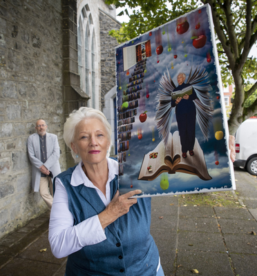 Marian Relihan from Lisselton with literary wings unfurled in the striking piece she collaborated on with Dave Morrison, in background. Photo by Domnick Walsh