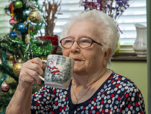 Betty at home drinking tea. Photo Domnick Walsh