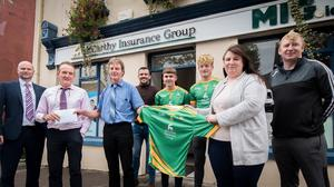 Pictured at a presentation of jerseys for the South Kerry minor and under 20 teams and also the announcement of a five year sponsorship of the South Kerry League by McCarthy Insurance Group Left to Right; Richard Halpin MIG Group, Michael O' Sullivan Treasurer SK Board, Gerard McCarthy Manager MIG Cahirsiveen, Mark Quigley SK Minor team Management, Kane O'Shea and Jack Clifford SK Minor team, Suzanne O'Leary SK Board Chairperson and Connie O'Connor SK minor Manager. PHOTO BY CHRISTY RIORDAN