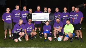 Batty Foley, Denis, Billy and Paul Russell presenting the cheque for €1,545 on behalf of the Covid All Stars team to Con O'Connor Co-Ordinator Pieta House Kerry with (front left) Eamonn Foley, Colm Conway, David O'Sullivan, Andrew O'Reilly, Aiden O'Connor (back) from left) Michael Cunningham, Micheál Ó Sé, Billy O'Mahony, Sean Costello, Martin Sweeney and Brian Gannon at the Dragon's Den, Killorglin on Monday. Photo by Michelle Cooper Galvin