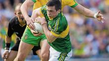 Kerry defender Paul Murphy, wrestling for possession with Colm McFadden, is the new breed of Kerry footballer, capable and willing to play the game on whatever terms necessary to win. Photo: Sportsfile