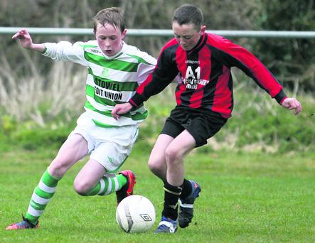 A serious tussle for possession between Listowel Celtic's Eoin O'Connor and Mastergeeha's Seán O'Leary during their U-14 Cup game at Tanavalla on Saturday afternoon. Photo: John Reidy