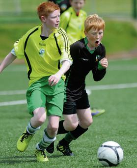 Anthony Darmody Killarney Celtic chased by Dan Goggin Kingdom Boys in the Kerry Schoolboys Under 14 clash at Celtic Park, Killarney on Saturday. Photo: Michelle Cooper Galvin